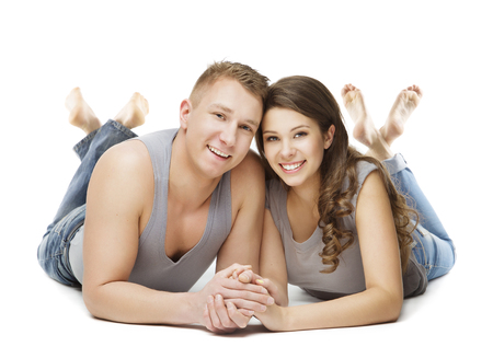 young adult man: Couple Lying over White Background, Happy Young Adult Man and Woman, People White Isolated Stock Photo