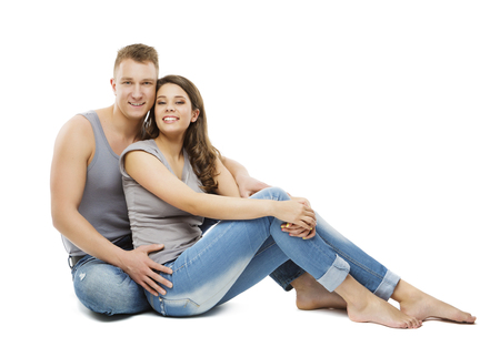 Couple Sitting over White Background, Happy Young Adult People, Isolated Man and Woman photo