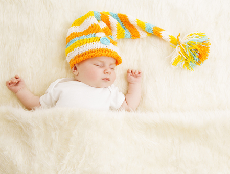 Baby Sleep in Hat, Sleeping Newborn Kid in Bed, Asleep New Born Child photo