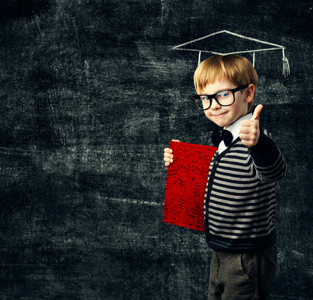 School Child Education Book, Kid in Glasses with Certificate, Graduation Hat on Blackboard Background, Thumbs Up photo