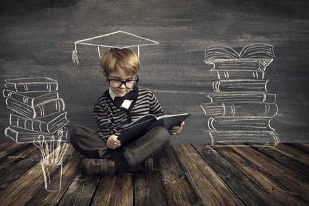 Children Education, Kid Read Book, School Boy Reading Dreaming About Books over Blackboard Background photo