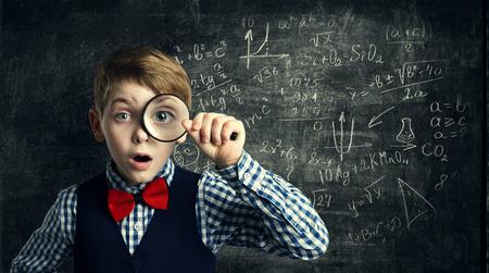 Child Magnifying Glass, Amazed School Kid, Student Boy with Magnifier Study Mathematics, Math Education photo