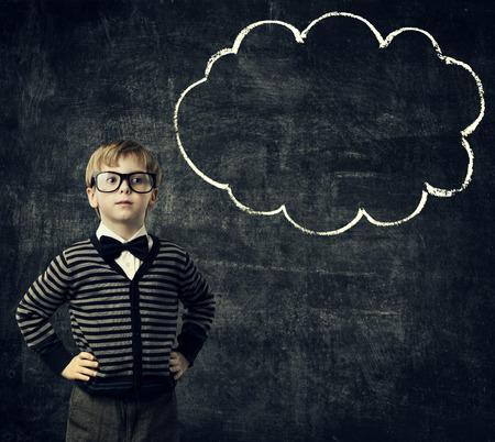 Kid in Glasses Think Bubble over Blackboard, Child Boy Thinking School Education, Black Background photo