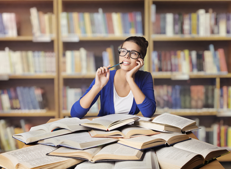 Woman in Library, Student Study Opened Books, Girl Studying and Thinking, School Education photo