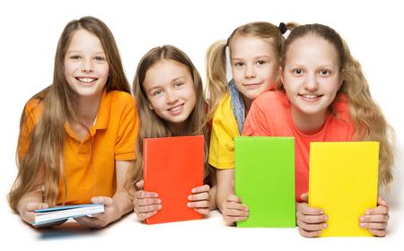 子供の本、子供女の子グループ本カバー、白い背景の上に横たわった少女 写真素材