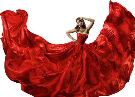 Dansende vrouw in rode jurk, mode-model dans in zijden baljurk, golvende vloeiende stof Stockfoto