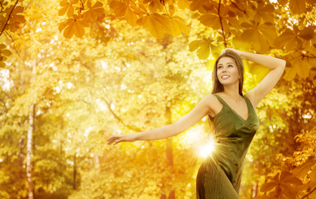 turn away: Autumn Woman, Happy Fashion Model in Yellow Forest, Beautiful Girl over Fall Leaves