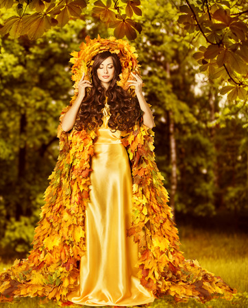 Autumn Woman, Fashion Model in Fall Forest, Girl in Autumnal Yellow Leaves Art Dress