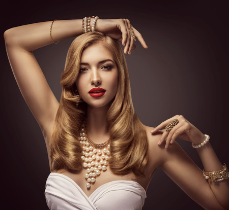 Woman Beauty Portrait, Fashion Model posing Jewelry necklace bracelet, Elegant Lady Makeup over Black Background