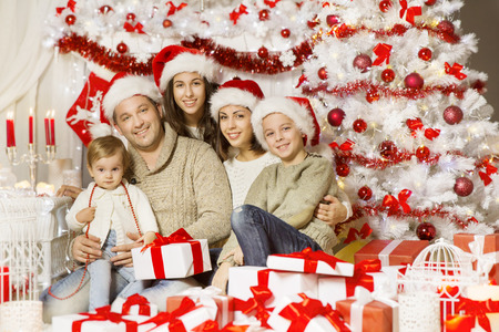 christmas family portrait happy father mother teenager child and baby with presents gifts decorated