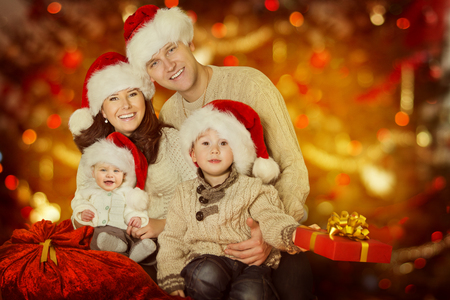 Christmas Family Portrait, Happy Father Mother Child and Baby With Present Gift Stock Photo
