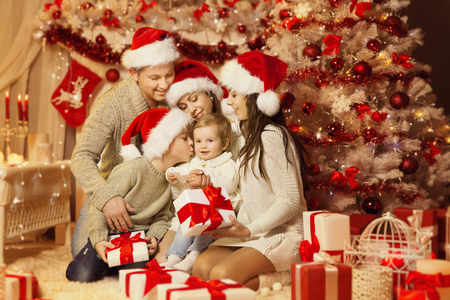 Christmas Family Portrait, Happy Father Mother Teenager Child and Baby,  Xmas Tree and Presents Gifts