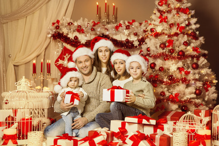 89281533 christmas family portrait happy father mother and children family with presents gifts under xmas tree