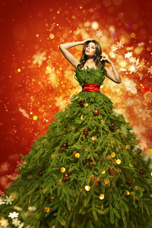 Christmas Tree Fashion Dress, Woman in Art Xmas Gown, New Year Girl in Snowflakes Stock Photo
