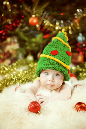 Newborn Baby Portrait, Happy New Born Kid, Child in Green New Year Tree Hat