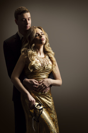 Couple in Love, Fashion Model Man and Woman Beauty Portrait, Dreaming Girl Well Dressed in Golden Dress