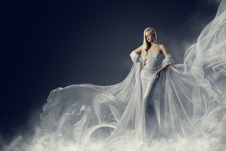 Fashion Model Beauty Dress, Waving Silver Cloth Gown, Woman in White Fluttering Clothes Fabric, over Night Background
