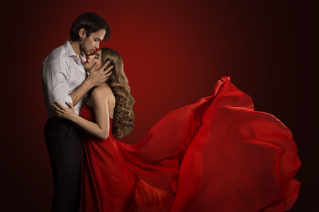 Kissing Couple, Young Man Kiss Beautiful Woman, Red Dress Waving Fabric, Romantic Love Concept