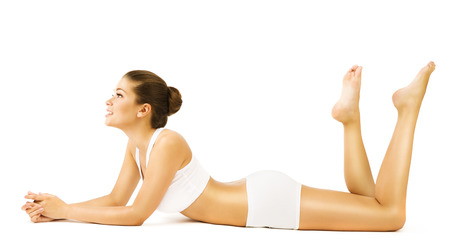 Woman Body Beauty, Young Sexy Girl in White Underwear Lying on Stomach and looking side, Young Model Isolated over white background Stock Photo
