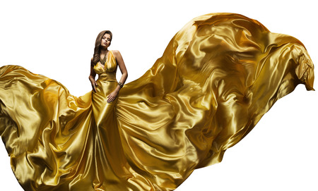 Fashion Model Golden Fly Dress, Elegant  Woman in Fluttering Gold Gown, Beautiful Girl and Silk Fabric Fly, Isolated on White Background 스톡 콘텐츠