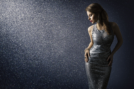 Silver Dress, Fashion Model Posing in Sparkling Sexy Gown, Elegant Woman Beauty Portrait on Lighting Sparkles Background