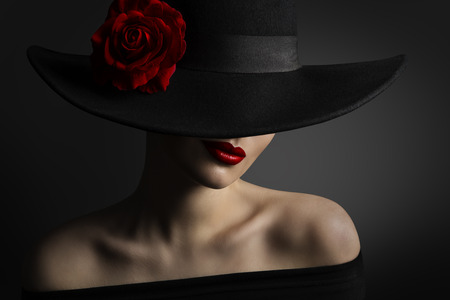 Woman Red Lips and Rose Flower in Hat, Fashion Model Beauty Portrait, Black Retro Wide Brimmed Hat Stock Photo