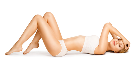 Body Beauty, Slim Woman in Cotton Underwear Lying Down on Back, Happy Dreaming Girl Isolated over White Background