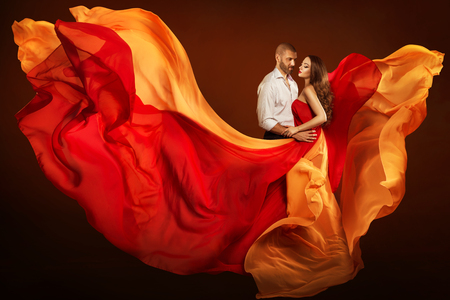 Couple Beauty Portrait, Dating Man and Dreaming Woman in Waving Flying Dress as Flame on Wind