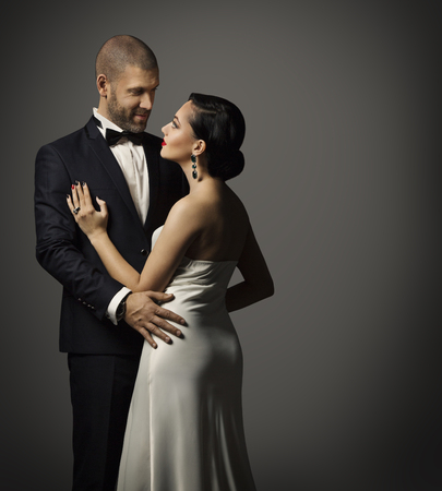 Couple Fashion Portrait, Embracing Man in Black Suit and Woman in White Dress