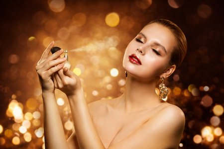 Perfume, Luxury Woman Spraying Fragrance, Aroma and Fashion Model Beauty Portrait