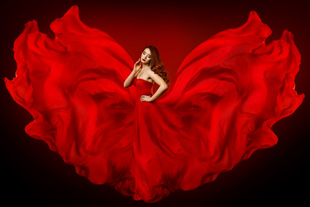 Woman Red Dress, Fashion Model in Long Silk Gown Waving Cloth as Wings, Fantasy Girl in Flying Fluttering Fabric Banco de Imagens