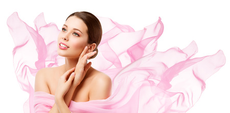 Beauty Makeup Skin Care, Woman Touching Face by Hand, Young Girl in Pink Waving Cloth over White Banco de Imagens