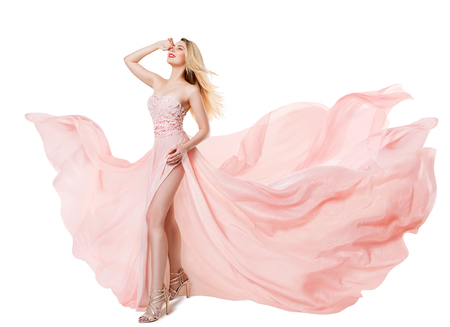 Woman Flying Pink Dress, Fashion Model in Long Waving Gown, Fluttering Fabric Isolated over White Background