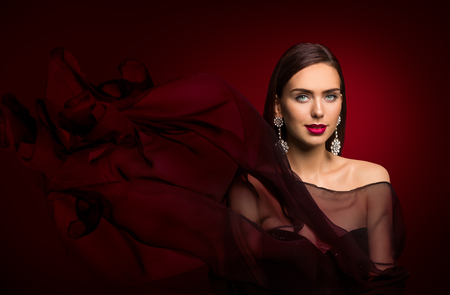 Woman Fashion Portrait, Elegant Model Makeup and Jewelry, over Dark Red Background