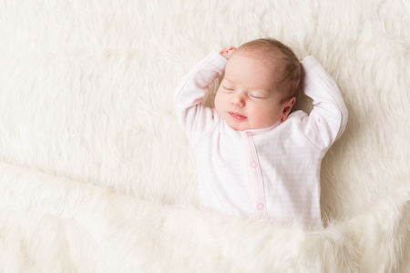 Sleeping Baby, New Born Kid Sleep in Bed, Beautiful Newborn Infant, One month old Archivio Fotografico