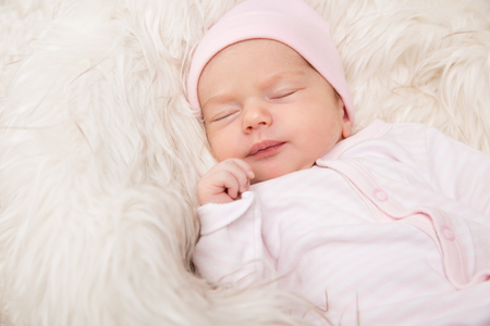 Sleeping Baby, New Born Kid Sleep in Fur, Beautiful Newborn Infant close up Portrait, One month old Archivio Fotografico