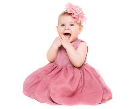 Bambina in abito, bambino felice su sfondo bianco, bellissimo ritratto di ragazza di un anno
