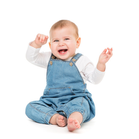Happy Baby, Infant Kid Sitting on white, Laughing One year old Child in Jeans