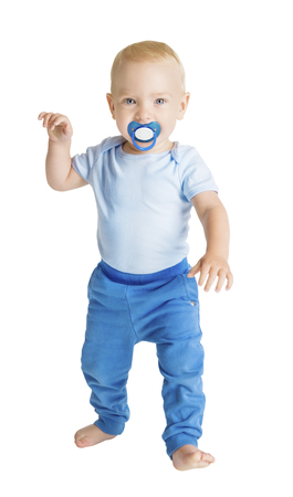 Baby Boy with Dummy full length portrait, Happy Kid Walking on White, Child One Year Old Banco de Imagens