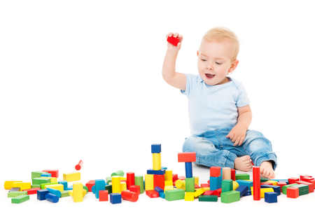 Baby Playing Toys Blocks, Kid Play Building Bricks, One Year Old Child on White Banco de Imagens