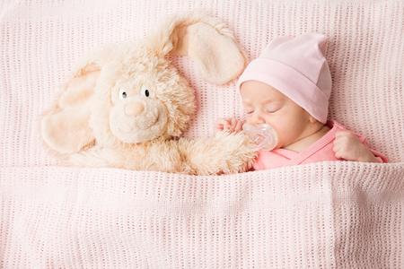 Sleeping Newborn Baby with Toy, New Born Kid Sleep covered by Blanket, Child Portrait two weeks old
