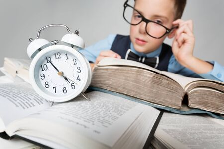 Child Reading Books behind Clock Alarm, School Boy Learning Hard Lessons, Time and Education