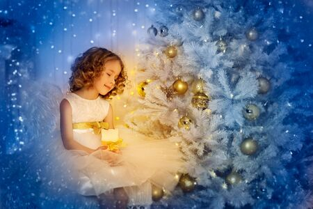 Child Girl and Christmas Tree, Happy, Kid in Candle Light Wishing Xmas Gift