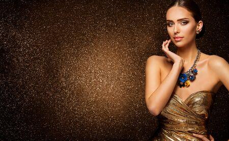 Fashion Model Beauty Portrait, Beautiful Elegant Woman in luxury gold dress on sparkling background