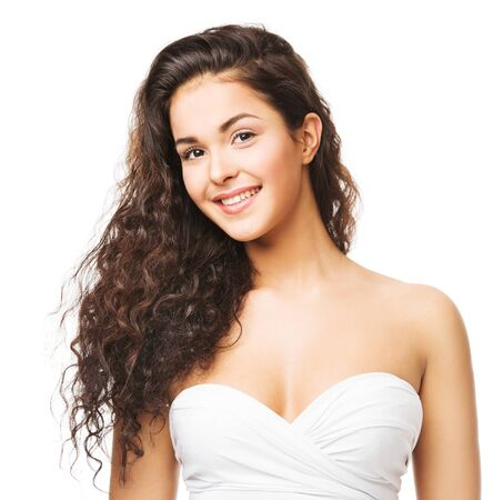 Brunette Woman with Long Wavy Hair. Beautiful Smiling Girl Portrait, Curly Hairstyle on White