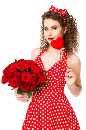 Woman with Heart and Flowers Roses Bouquet in Red Polka Dots Dress, Beautiful Fashion Model Beauty Portrait on white