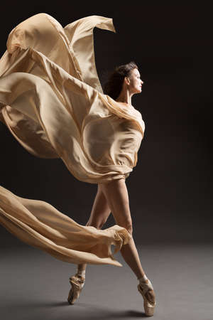 Ballerina Dance with Silk Fabric, Ballet Dancer in Pointe Shoes, Flying Beige Cloth, Gray Background