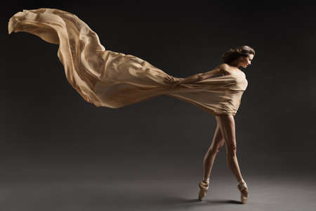 Ballerina Walking with Silk Fabric, Modern Ballet Dancer in Pointe Shoes, Fluttering Waving Cloth, Gray Background