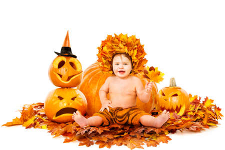 Autumn Happy Baby Portrait, Cute Kid in Fall Leaves Hat next to Pumpkin, Sitting on Maple Leaves over Isolated White Background