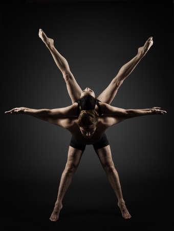 Ballet Dancers Posing over Black Background. Modern Ballerina Couple Silhouette